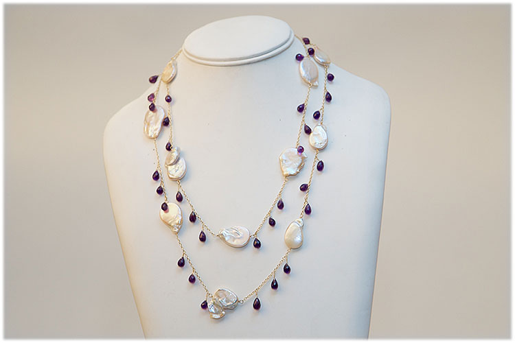 Large flat sweet water pearl and amethyst necklace.